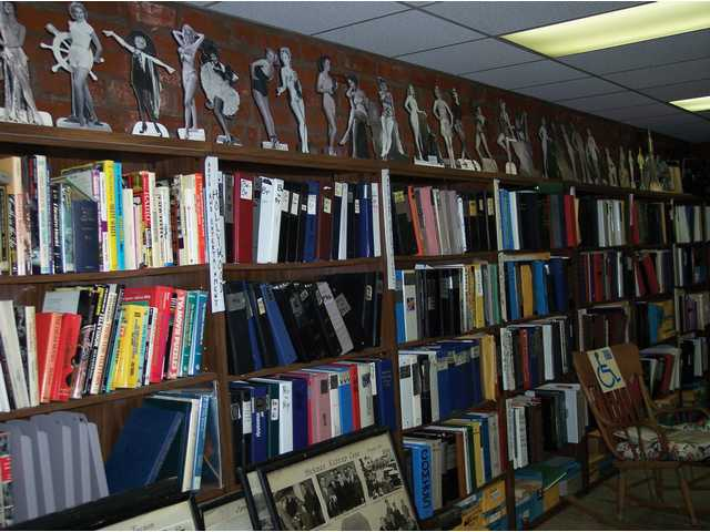 Three-ring binders contain images from throughout the 20th century and span topics as diverse as lynchings to sports.