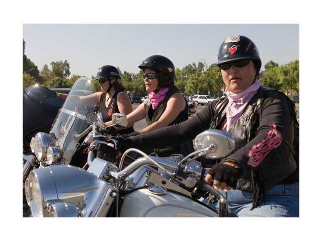 Wendy Bentley, left, Donna Cottone, center, and Marcelle Murr gear up before the 13th annual Downed Officer Support Ride at the Valencia Town Center on Sunday. These ladies have supported the ride for over four years.