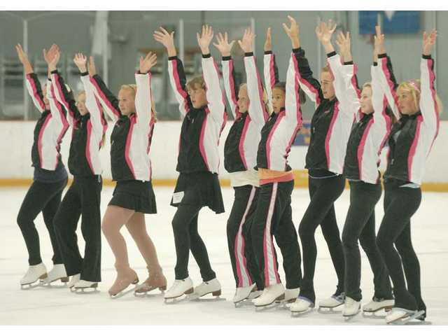 "The California Girls synchro team strikes a pose as they practice to music of ""Austin Powers."" The team took top marks for their performances at the Ice Skating Institute World Recreational Team Championship."