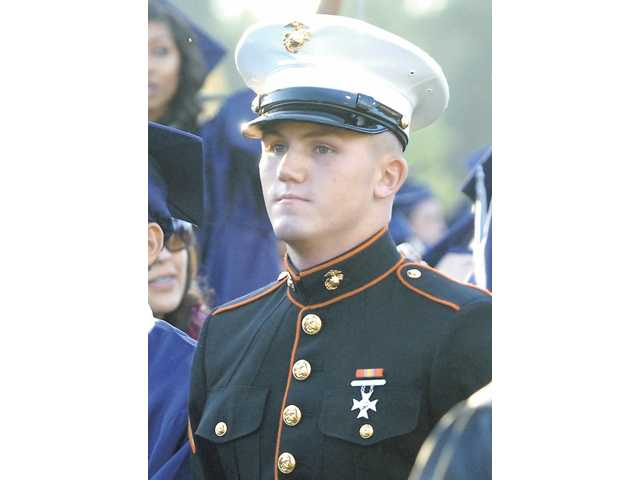 Nicholas Laccabue wears his U.S. Marine uniform at his Saugus High School graduation ceremony at College of the Canyons on June 3. The bill is expected to pass through the Assembly today.