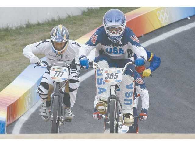 Santa Clarita's Mike Day leads Marc Willers of New Zealand in Wednesday's BMX quarterfinals at the Olympic Games in Beijing.