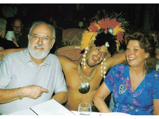 Frank, left, and Charlotte Kleeman have a little fun with their waiter during a 1999 cruise through the Tahitian islands.