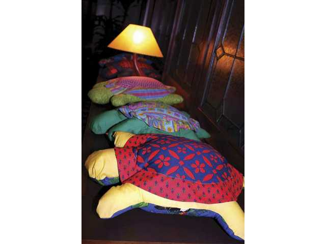 Colorful stuffed turtles were awarded to everyone who wrote a check on Saturday night to support the Painted Turtle Camp for children with chronic illness in Lake Hughes.
