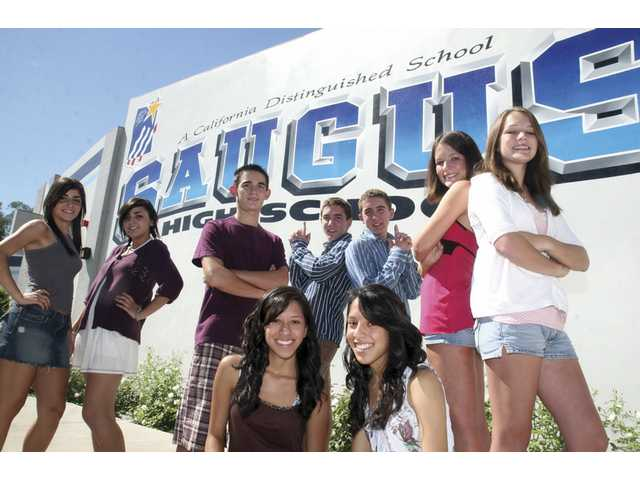Saugus High School Principal Bill Bolde stands with a few of the 27 sets of twins attending the school this year.