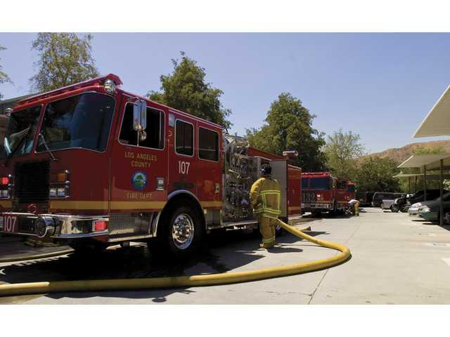 Los Angeles County Fire Department engines meet outside a Canyon Country apartment complex where a kitchen fire destroyed one apartment.