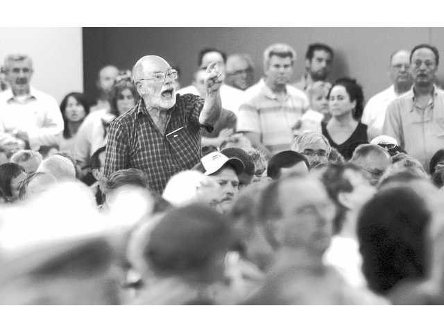A man upset with the proposed health reform bill stands to make a point during a town hall meeting held by U.S. Rep Peter DeFazio at the Douglas County Fairgrounds in Roseburg, Ore. on Wednesday.