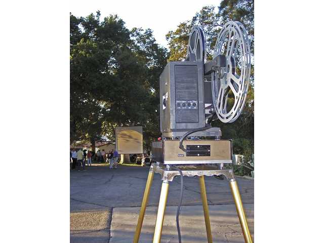 "The arc light projector used by silent film preservationist David Shepard waits for dusk to settle before it brings the William S. Hart silent film, ""Three Word Brand"" to life on the screen."