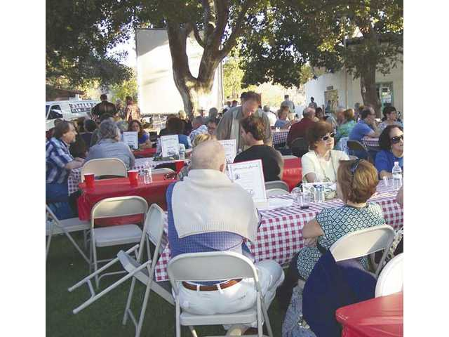 Guests socialize as they wait for the Rattler's barbecue dinner to be served at Silents Under the Stars in the backyard of Bill Hart's mansion in Newhall.