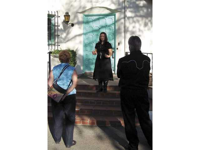 Ayesha Saletore, Hart museum administrator, greets guests before they begin the tour of the Hart Mansion at Silents Under the Stars.