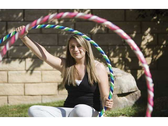Jackie Kasaback, a 14-year-old high school student, has started her own business of making and selling hula hoops as well as offering classes.