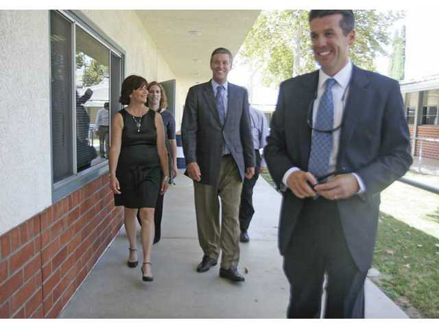 From left, Sue Solomon and State Superintendent of Instruction Jack O'Connell, follow principal Mike Kuhlman around Placerita Junior High School Monday afternoon. O'Connell got a tour of the finished modernization project which was worked on over the summer.