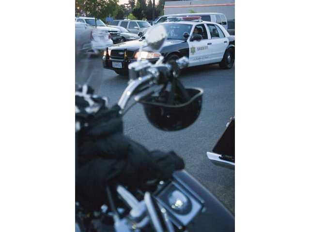 A sheriff deputy patrols around the Route 66's bike night back in May 2009.