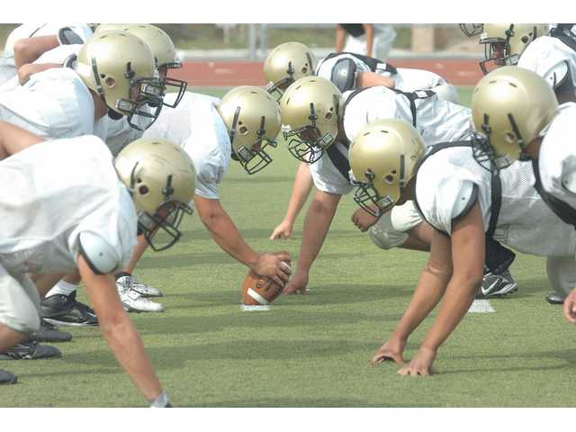 Golden Valley lines up in the trenches during Friday's practice at Golden Valley High School. The Grizzlies have a full scout team for the first time in program history and are taking advantage of it.