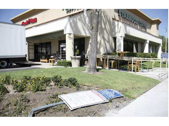 A car accident caused a fire hydrant on Bouquet Canyon Road and Susan Beth Way to burst on Tuesday, resulting in water damage and a collapsed roof at the nearby Starbucks Coffee and and Chronic Taco.