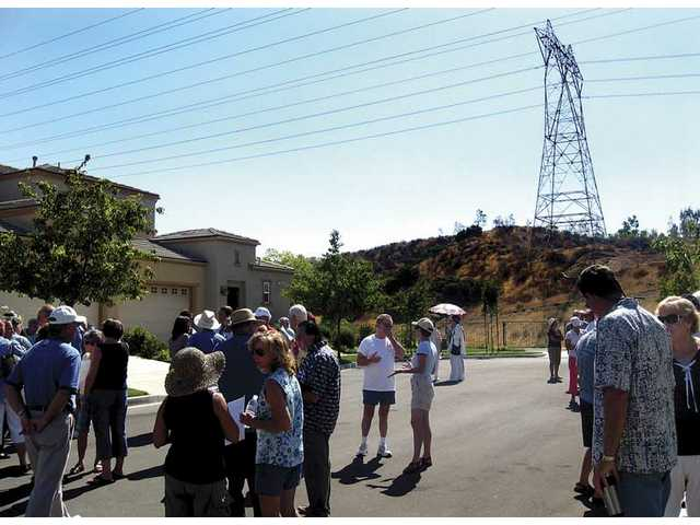 Residents of the Valencia neighborhood Northbridge gather Tuesday to protest Southern California Edison's 150-foot electric line towers.