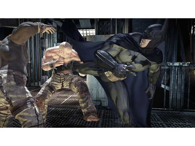 "Batman battles some of the Joker's henchmen in ""Batman: Arkham Asylum."""