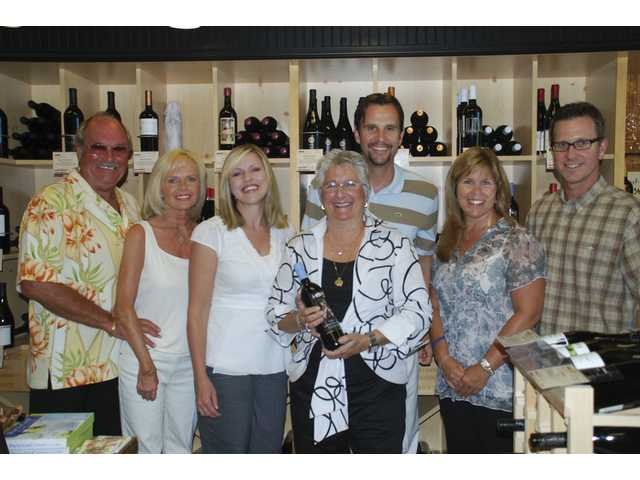 Lil Lepore, center, co-founder of Vino 100 Valencia is joined by host committee members, left to right, Don and Cheri Fleming, Lena and Cameron Smyth, Laurie and Chris Ender.