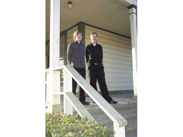 Brandon Alvis and Justin Pfeiffer, of the American Paranormal Research Association of Bakersfield, will host a ghost-hunting party Saturday at Heritage Junction in Newhall to benefit the SCV Historical Society. The duo stand on the steps of the Newhall Ranch House, which has been the reported scene of several ghost sightings. The event is a fundraiser for the SCV Historical Society. For information contact Pat Saletore (661) 254-1275.