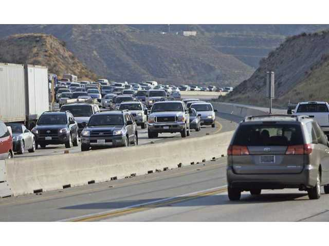 Traffic northbound on Highway 14 freeway backed up from Soldedad Canyon Road until south of Agua Dulce Canyon Road due to a 3-acre fire that came close to the freeway Thursday afternoon and forced the closure of three lanes.