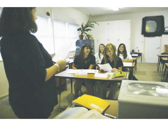 Latin teacher Lucy Banduk teaches the language to a small group of ninth graders at Trinity Classical Academy in Newhall. Students meet at the Seventh Day Adventist Church, but their new location, which will be ready in 2009, will be on Kelly Johnson Parkway in Valencia.