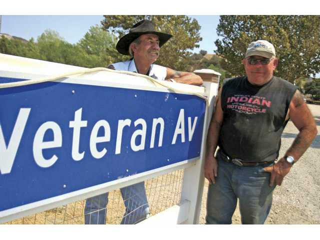 Vietnam Navy veteran John Sloan, left, and Naval Mobile Construction Batallion veteran John Olesh are currently dealing with the Department of Regional Planning because the veterans are opposed to the plot plans organization is enforcing for the VFW Post 6885 in Canyon Country.