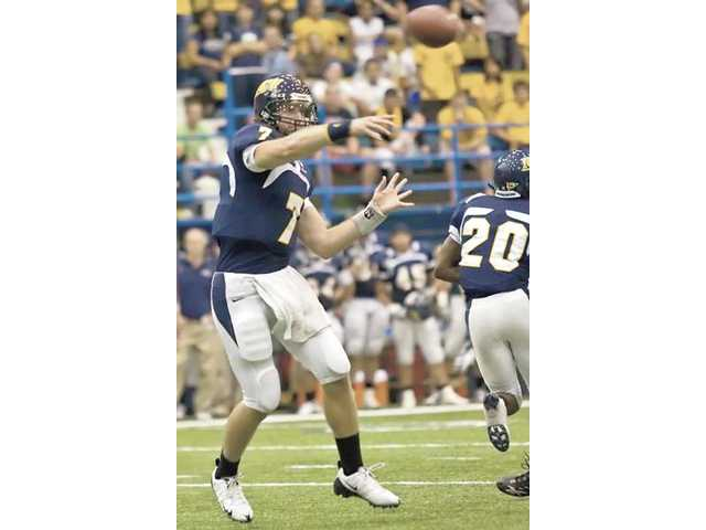 Valencia High graduate and Northern Arizona University quarterback Michael Herrick throws a pass in this undated photo.