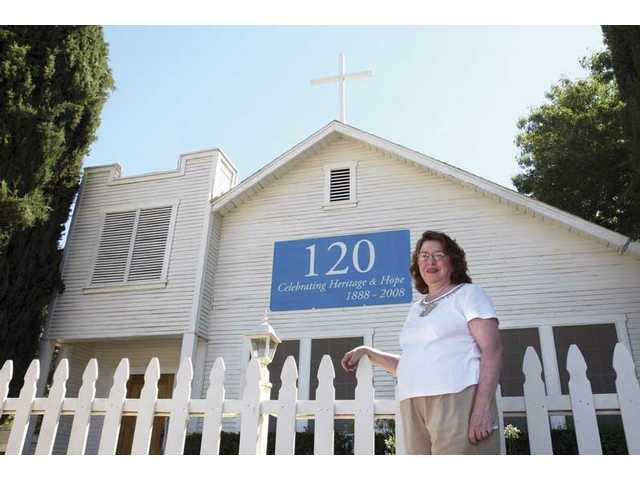 Rev. Dr. Judith A. Hirsch-Fikejs, pastor of Acton Community Church, stands outside the church Wednesday. The church in the rural enclave of the valley is celebrating its 120 year anniversary.