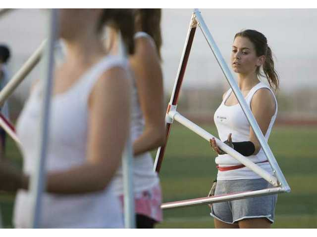 Liz Molloy works on spinning a triangle during band practice at West Ranch High School on Thursday evening.