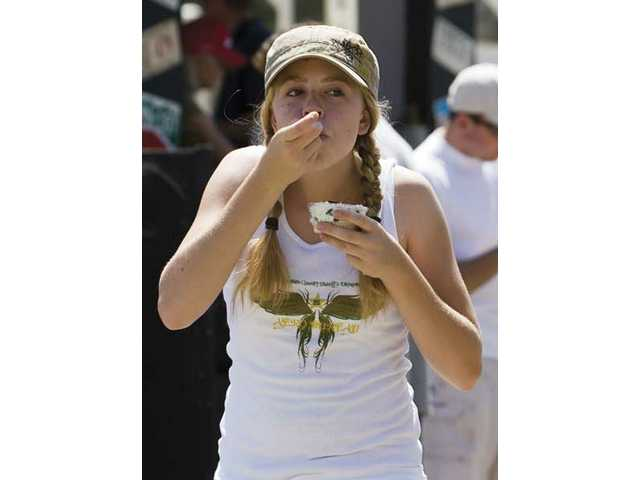 Lauren Allen, 14, from Canyon Country, walks around tasting different varieties of chili.