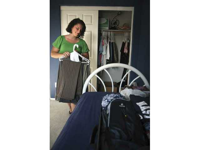 In her Newhall home, Meghan Walter, a 20-year-old Master's College Student, packs some of her belongings for a three-and-a-half month trip to Israel through the college's Israel Bible Extension program.