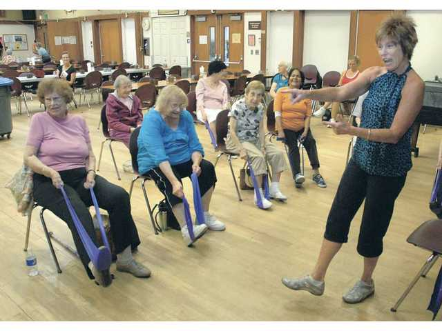 Linda Bennett, certified instructor for PACE, encourages the Senior Center class as they do an ankle exercise. PACE, which stands for 'People with Arthritis Can Exercise,' is an interactive class that leads participants through a series of stretches and movements that keep the joints moving and help keep bones strong and healthy.