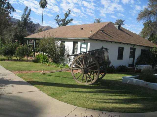 The historic school house at Rancho Camulos. The wagon dates from the 1800s and belongs to the Villar family. They bring it out to the site every year for Ramona Days.
