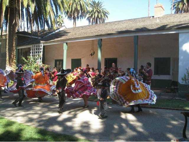 Members of Groupo Folklorico Tecalitlan dance on the veranda of the main (1853) adobe building.