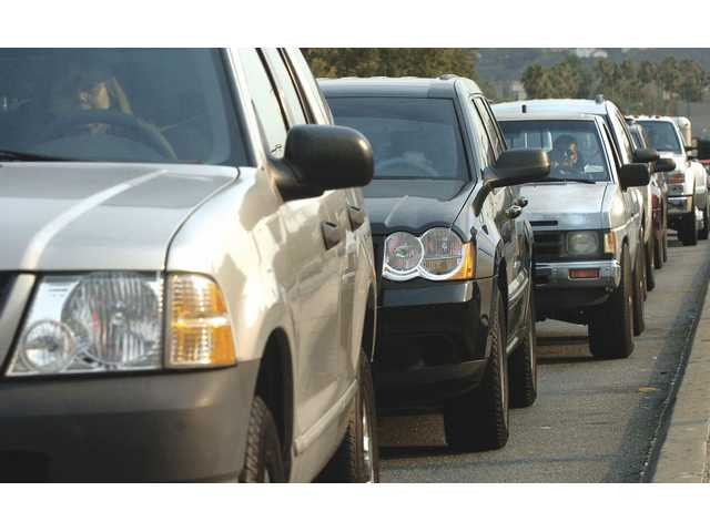 Drivers wait to make a left turn onto Soledad Canyon Road from Sierra Highway in Canyon Country at 5 p.m. on Thursday.