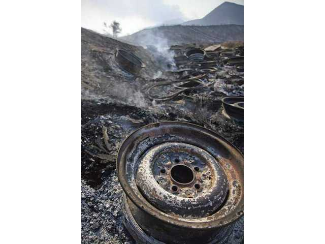 Rims and other remnants are all that remain in this land near Soledad Canyon Road and Bootlegger Canyon Road Monday afternoon after the Station Fire burned through the Acton area Sunday night.