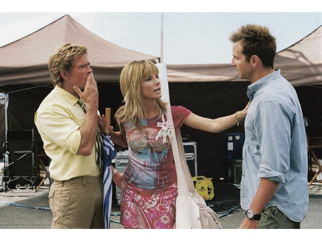 "Thomas Haden Church, left, Sandra Bullock, center, and Bradley Cooper are shown in ""All About Steve."""