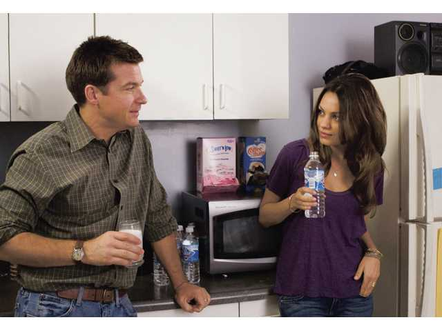 "Jason Bateman stars as Joel, left, and Mila Kunis stars as Cindy in a scene from Miramax's ""Extract."""
