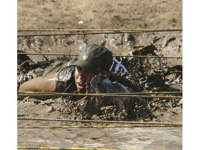 Mark Schoelen dashes with speed through the Big Daddy mud pit. To register for the run, go to www.LASD.org or call the Special Enforcement Bureau at (323) 881-7800.