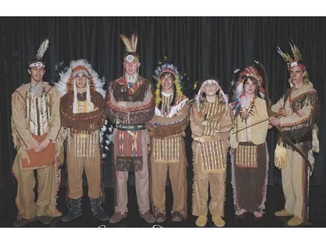 Serrano Dancers, members of the Serrano Chapter of the Order of the Arrow, pose in dance regalia. Left to right, Matt Van Grinsven, Marc Seltzer, Curtis Van Grinsven, Luke Seltzer, Christopher Howell, Ethan Reynolds and Johnny Howell.