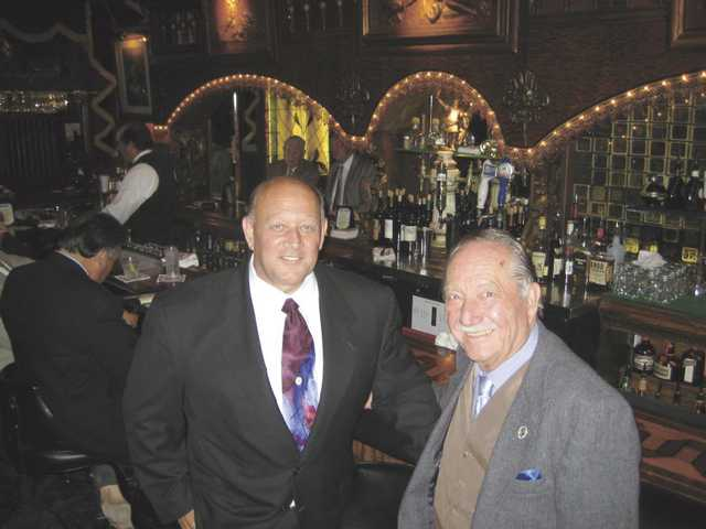 Magic Castle President Robert Lamoureux, left, socializes with founder Milt Larsen at one of the five bars in the Magic Castle in Hollywood.