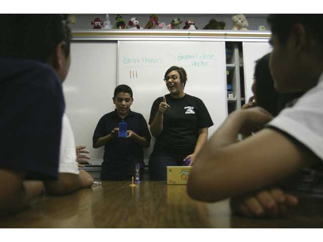 Christine Parr, a teacher at Placerita Junior High School, cheers as a student guesses an answer correctly in a game of Taboo, which she uses to teach the English language.