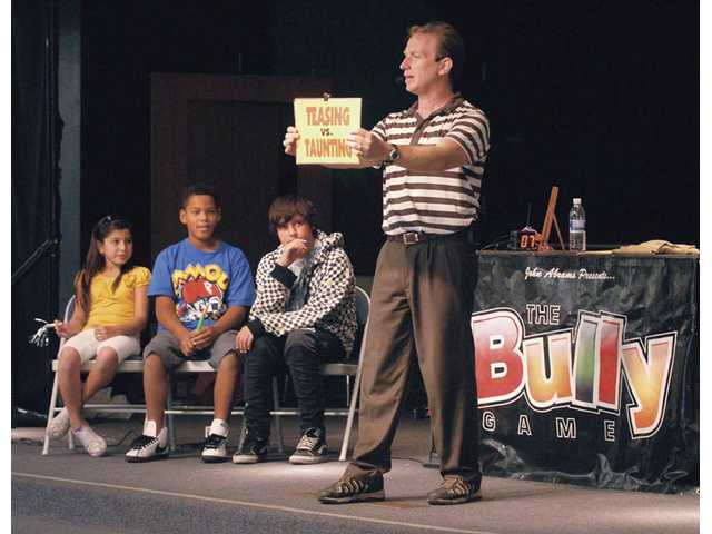 John Abrams demonstrates the difference between teasing and taunting as about 300 Rio Vista Elementary fifth- and sixth-grade students learn about bullying and gossip on Friday.