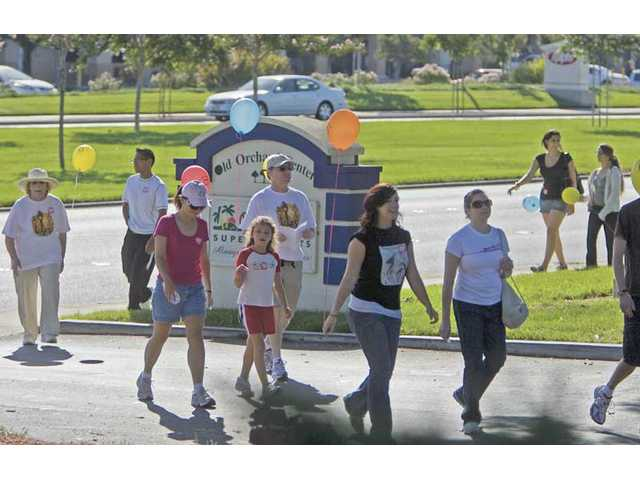 Santa Clarita residents head back from St. Stephen's Episcopal Church after walking 4.5 miles for the 13th annual SCV Community Walk for the Hungry on Monday morning. The walk was organized by Church World Service.