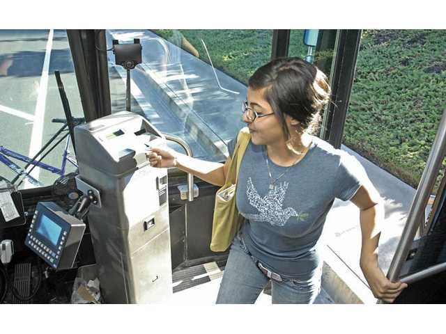 College of the Canyons psychology student Jesenia Castaneda, 18, swipes her free bus card as she gets on the Santa Clarita transit after class Tuesday afternoon.