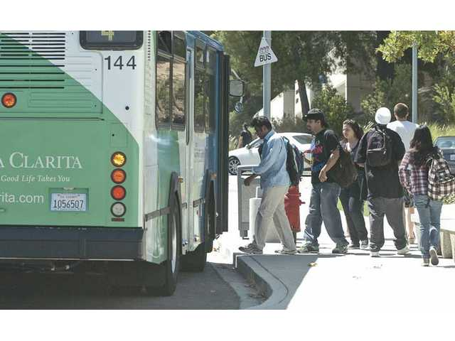 A City of Santa Clarita bus picks up and drops off students at College of the Canyons off Rockwell Canyon Road on Tuesday.
