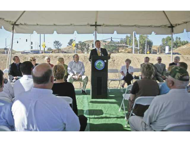 Chairman of MTA Ara Naharian speaks during the Grand Opening for the Magic Mountain/Interstate 5 Expansion Project at the corner of Magic Mountain Parkway and The Old Road on Tuesday.