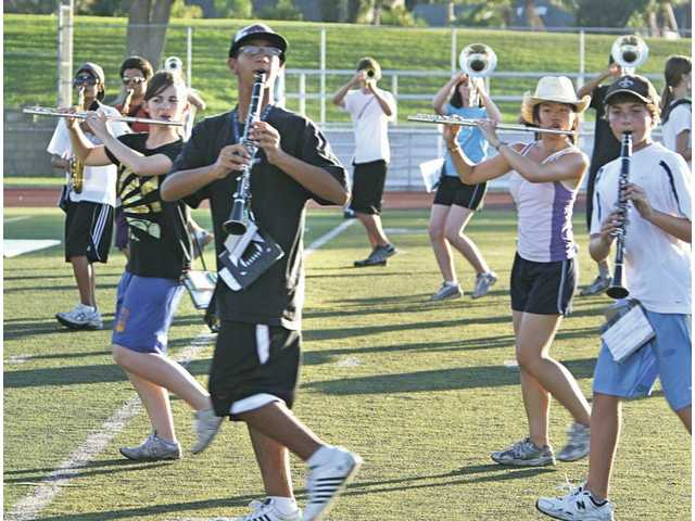 "The 120 members of the Hart High Regiment Band members march as they practice their musical number  ""Winter"" at band at their practice on Saturday on the Hart High football field."