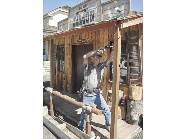 Volunteer Ed Marg works on Murphy's Saloon at Heritage Junction in preparation of Heritage Haunt.