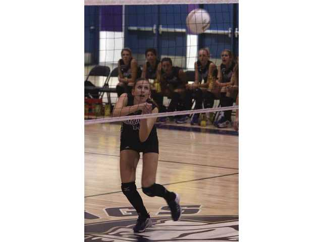 Katie Hank is a key outside hitter who helped lead a Valencia team that finished undefeated in the Foothill League.