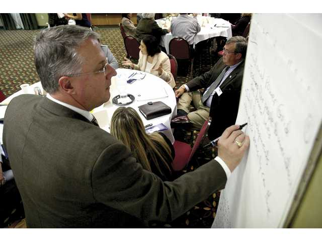 Andy Pattantyus takes notes during the Valley Industrial Association's symposium in May. The business advocacy organization will host a panel on workforce housing on Tuesday.
